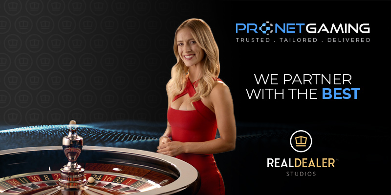 """Pronet Gaming logo in top right corner. """"We partner with the best"""". RealDealer Studios logo at bottom. Blonde live dealer in centre with roulette table"""