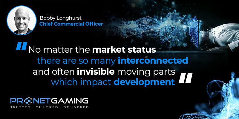 """CCO Bobby Longhurst headshot in top left corner. Pronet Gaming logo in bottom left. Quote from Intergaming article is """"No matter the market status there are so many interconnected and often invisible moving parts which impact development"""""""