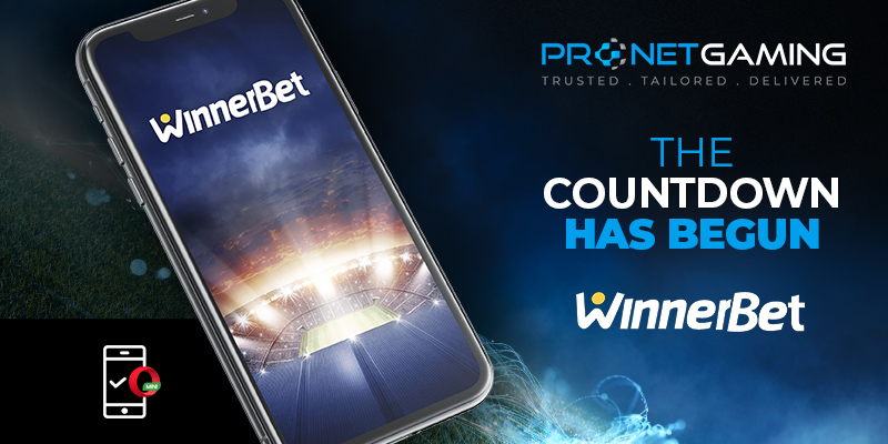 "Pronet Gaming logo in top right corner. Winnerbet logo in bottom right corner. ""The Countdown has begun"". Smartphone shows Winnerbet logo above football stadium. Opera mini logo in bottom left corner"